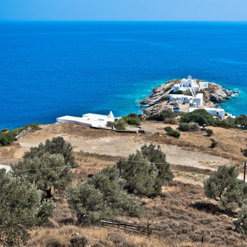 A little peninsula with the church of Chrisopigi on the island of Sifnos in Greece
